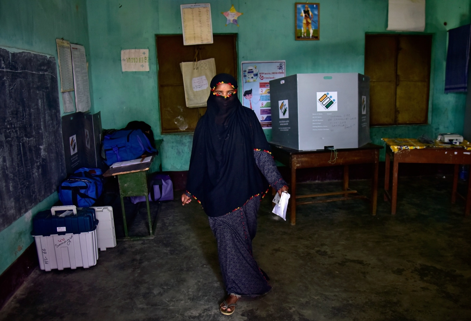 A veiled woman leaves after casting her vote at a polling station during the first phase of general election in Nagaon district in the northeastern state of Assam, India, April 11, 2019. REUTERS/Anuwar Hazarika