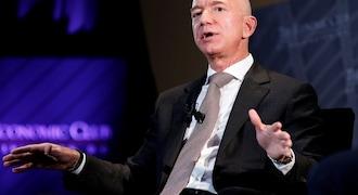 Amazon's Jeff Bezos challenges retail rivals to raise minimum wages