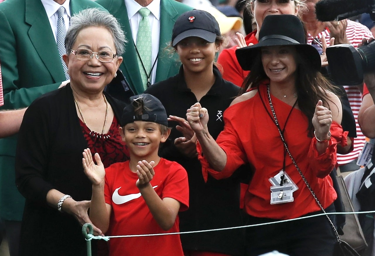 Golf - Masters - Augusta National Golf Club - Augusta, Georgia, US - April 14, 2019 - Tiger Woods' family, daughter Sam Alexis, son Charlie Axel, mother Kultida woods (L) and girlfriend Erica Herman, smile has he approaches them after he won the 2019 Masters. (Reuters)