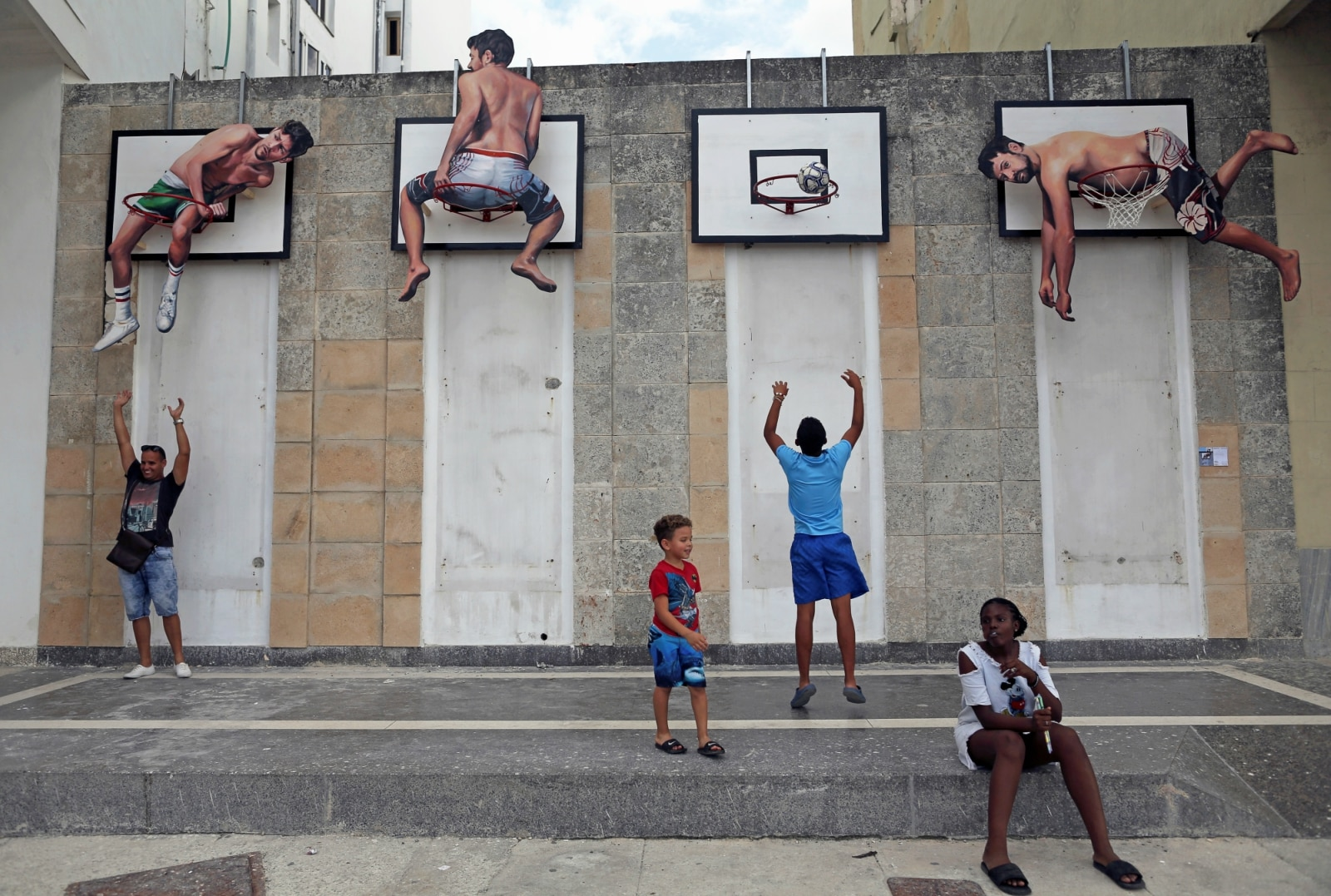 Children play basketball with an installation by Spanish artists Martin and Sicilia during the 13th Havana Biennial, in Havana, Cuba April 12, 2019. REUTERS/Fernando Medina