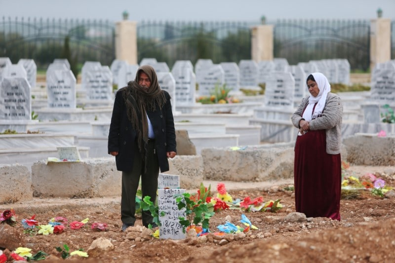 A woman reacts at a grave of her daughter, an SDF fighter killed during fightings with Islamic State militants, at a cemetery in Kobani, Syria April 4, 2019. Picture taken April 4, 2019. REUTERS/Ali Hashisho