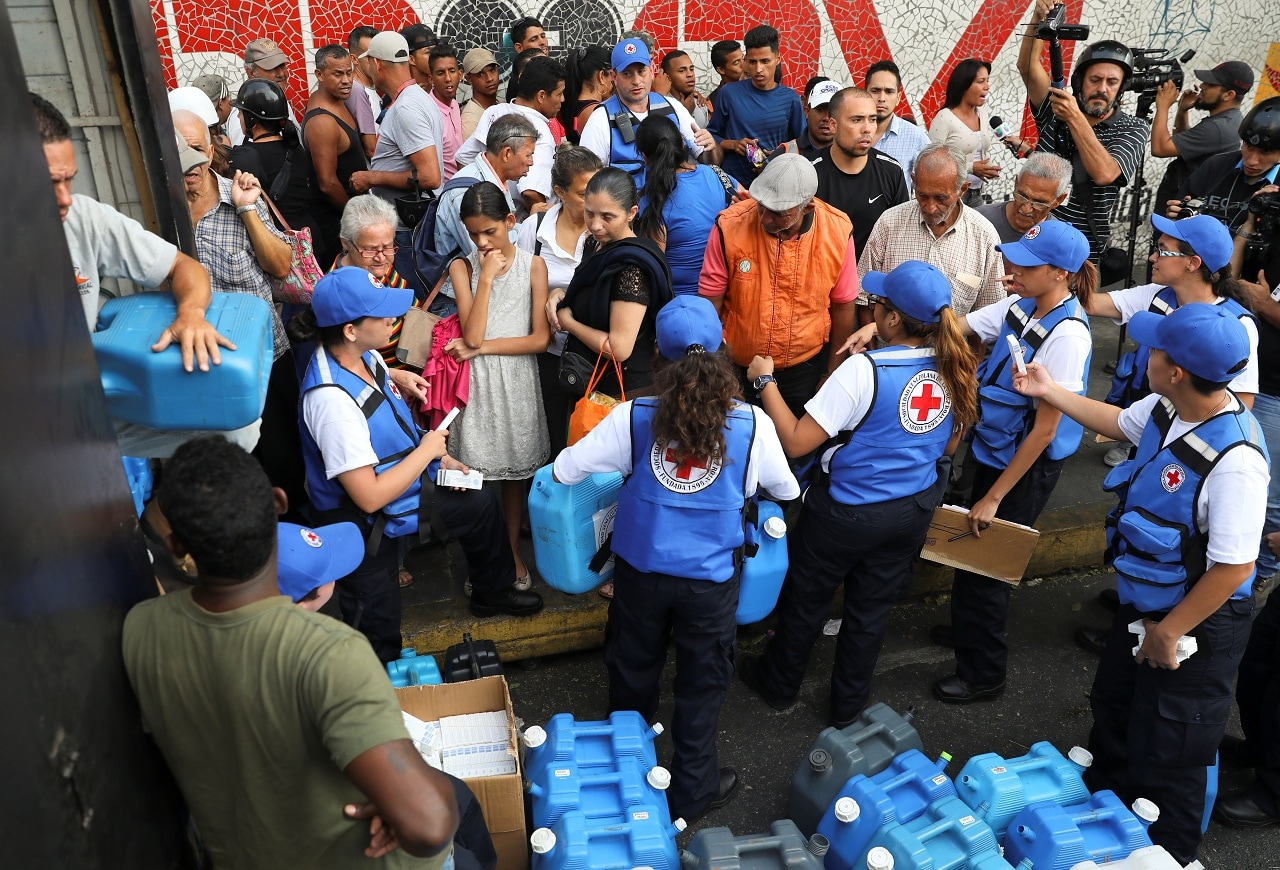 Shipment, which arrived via airplane from Panama, included 14 power generators, 5,000 litres of distilled water, and three surgery equipment kits capable of serving 10,000 patients each, according to the Red Cross. REUTERS/Manaure Quintero