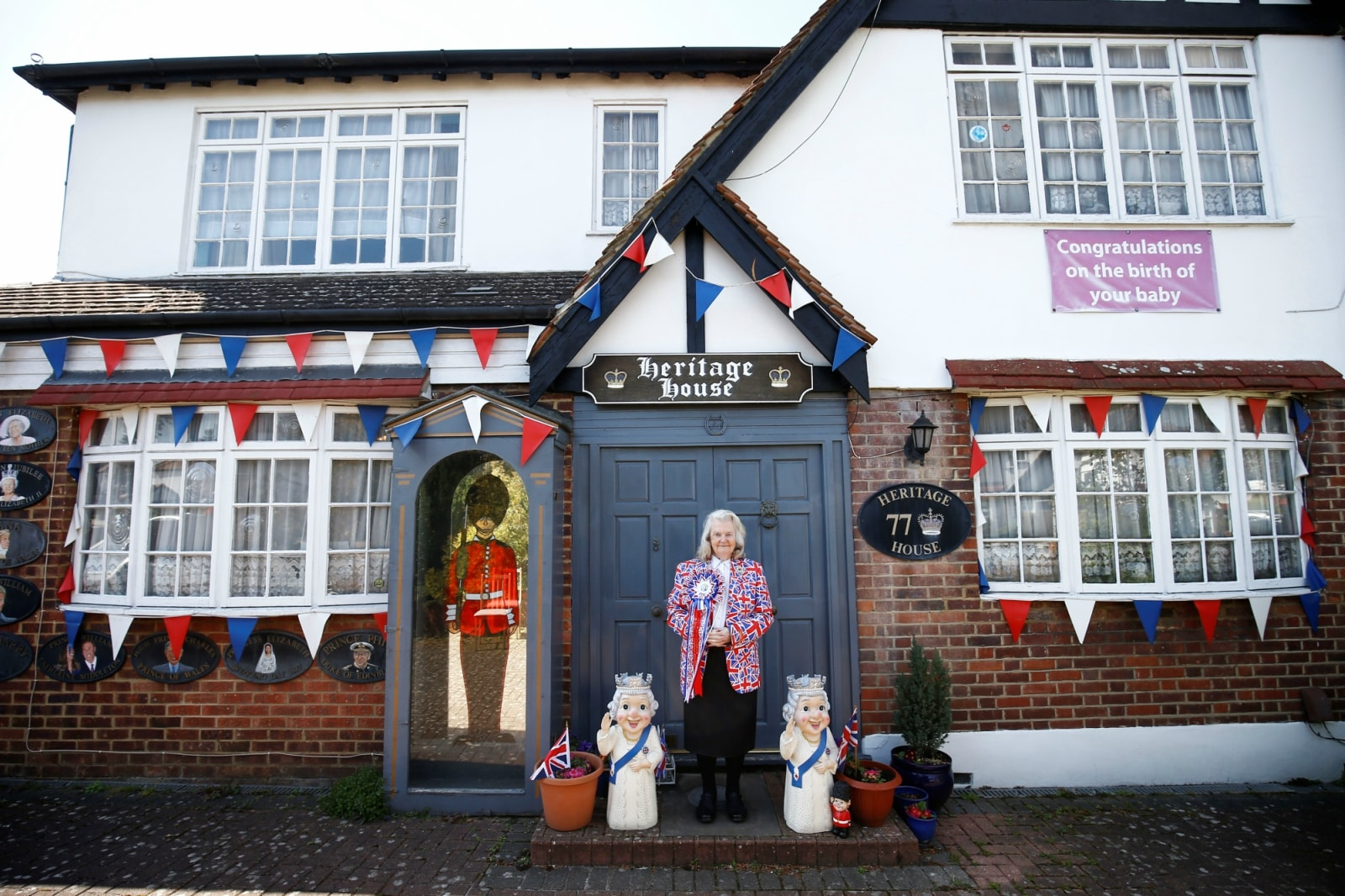 Royal fan Margaret Tyler poses outside of her home in north London, Britain April 10, 2019. REUTERS/Henry Nicholls/Files