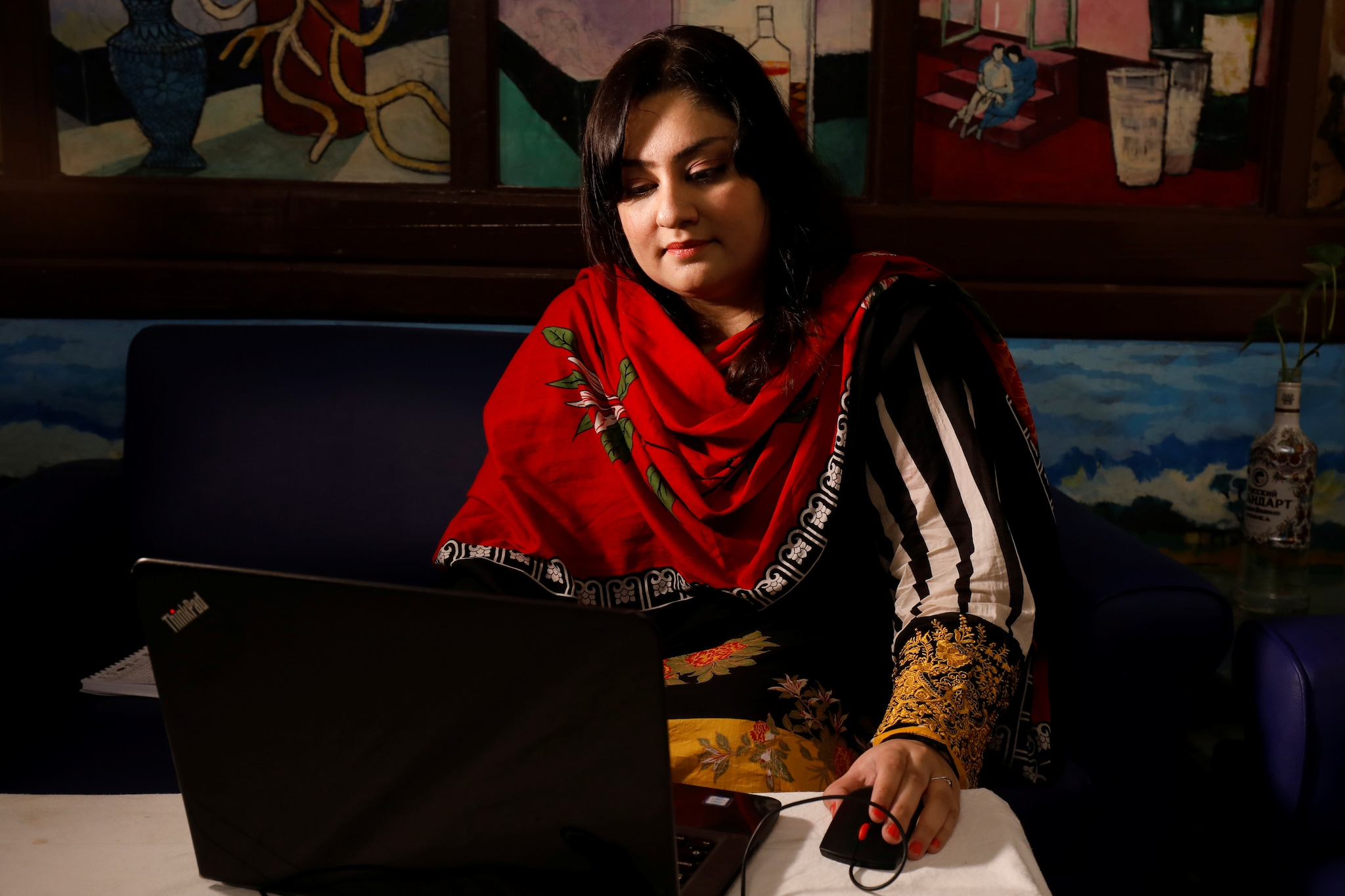 Mah Jabeen, 36, who runs a Meghan Markle fan page, is seen working on computer during an interview with Reuters, ahead of the birth of Prince Harry and Meghan's first baby, in Karachi, Pakistan April 11, 2019. REUTERS/Akhtar Soomro/Files