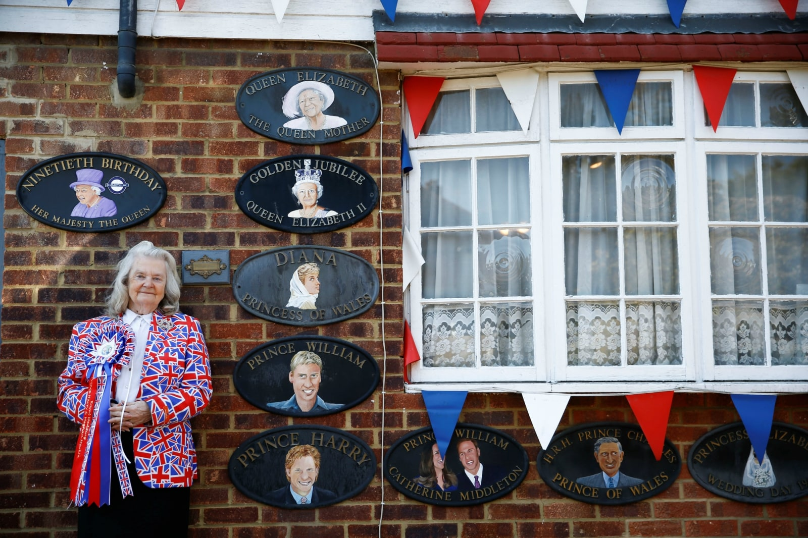 Royal fan Margaret Tyler poses outside of her home, which is decorated with Royal Family memorabilia, in north London, Britain April 10, 2019. REUTERS/Henry Nicholls/Files