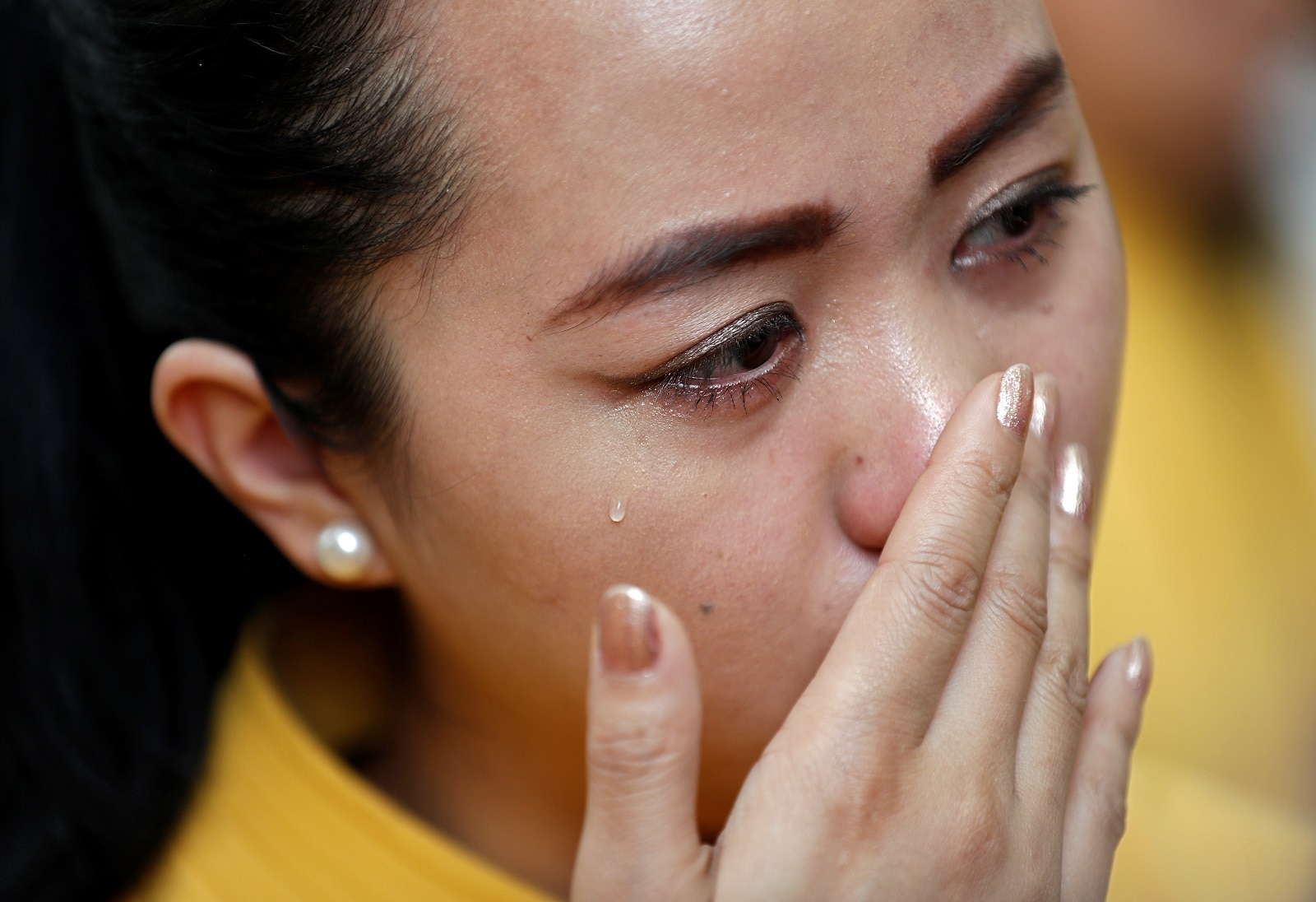 A flight steward of Jet Airways weeps during a protest demanding to