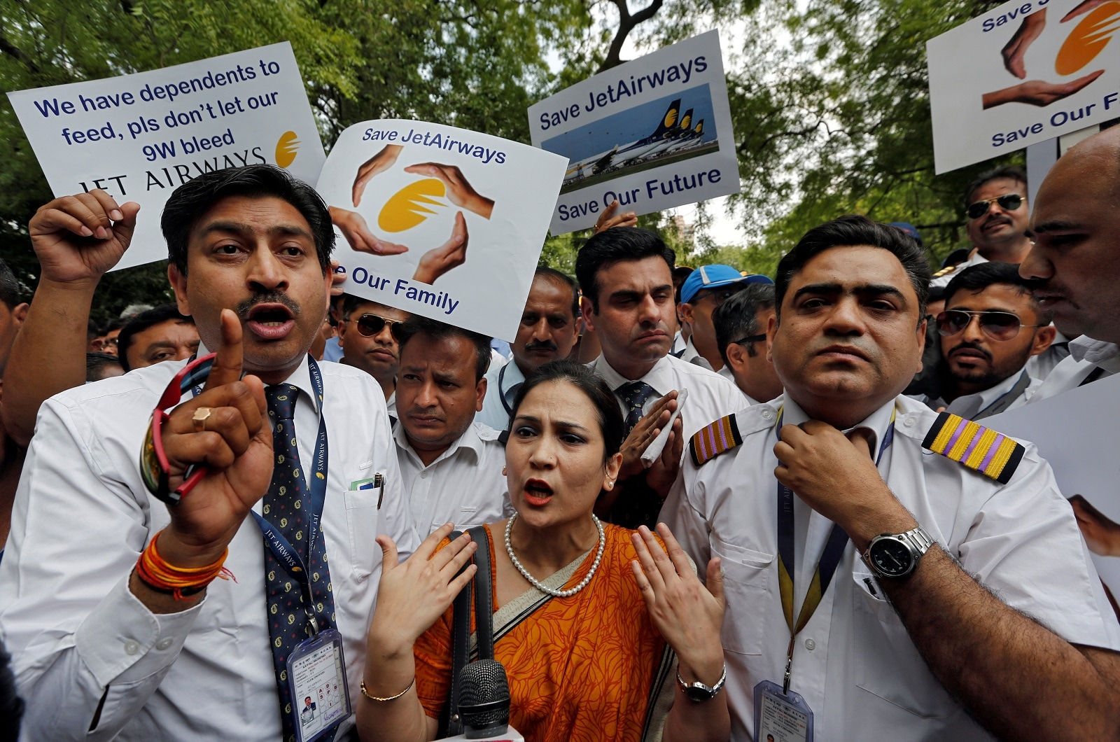 Jet Airways employees and their family members attend a protest demanding to
