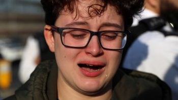 Weeping teenage climate activists in peaceful protest near London's Heathrow