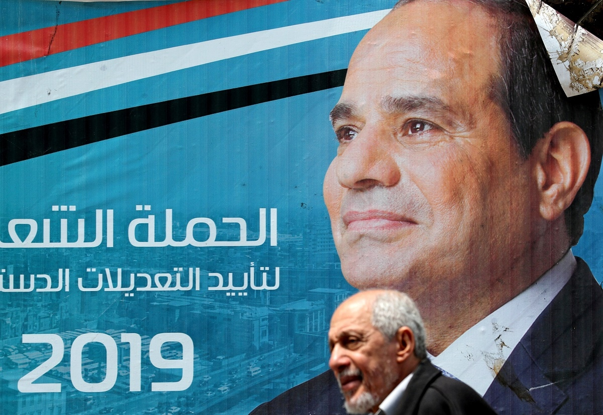 A man walks in front of a banner depicting Egyptian President Abdel Fattah al-Sisi before the upcoming referendum on constitutional amendments in Cairo. (REUTERS/Mohamed Abd El Ghany/Files)