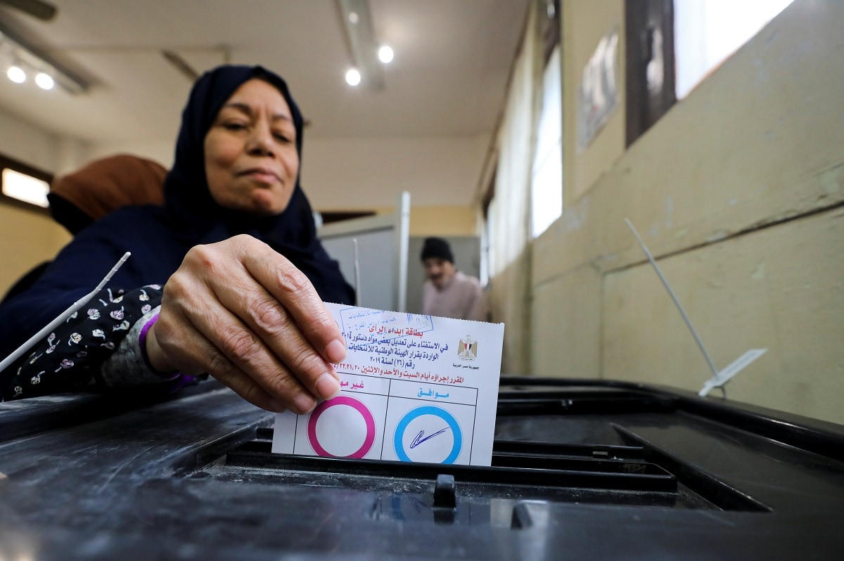 A woman casts her vote during the referendum on draft constitutional amendments, at a polling station in Cairo. (REUTERS/Mohamed Abd El Ghany)