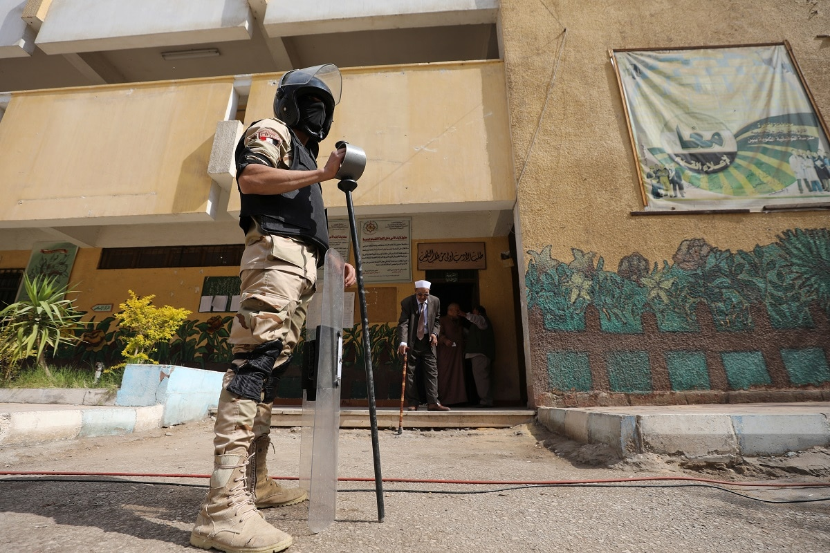 An army soldier stands guard at a polling station, during the referendum on draft constitutional amendments, in Cairo. (REUTERS/Mohamed Abd El Ghany)