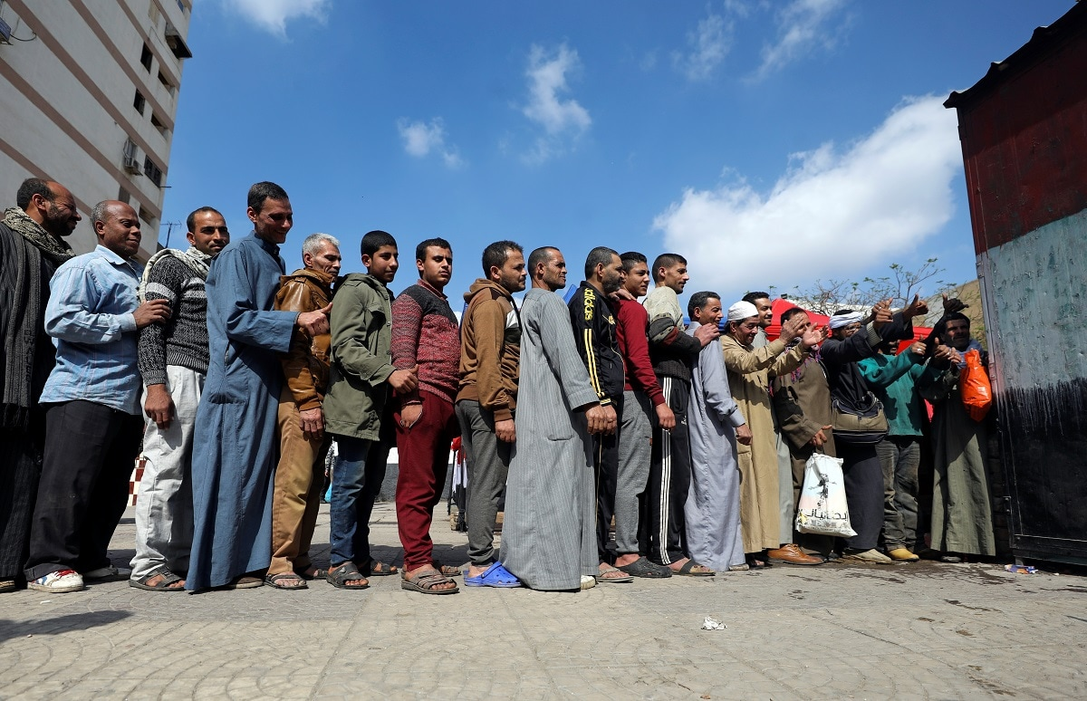 People stand in line to cast their vote during the referendum on draft constitutional amendments, at a polling station in Cairo. (REUTERS/Mohamed Abd El Ghany)