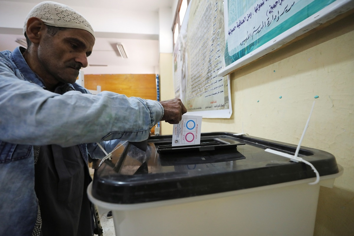 A man casts his vote during the referendum on draft constitutional amendments, at a polling station in Cairo. (REUTERS/Mohamed Abd El Ghany)