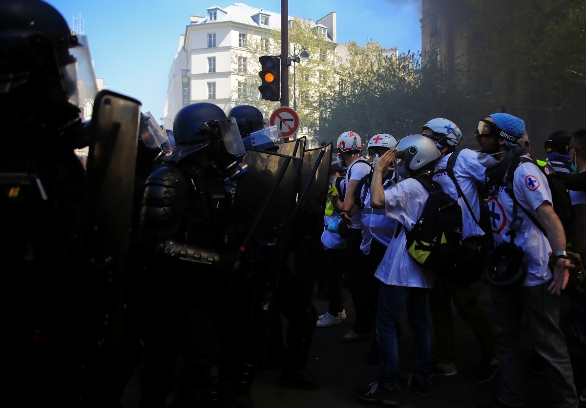 Police officers in riot gear confront protesters at a demonstration. (REUTERS/Gonzalo Fuentes)