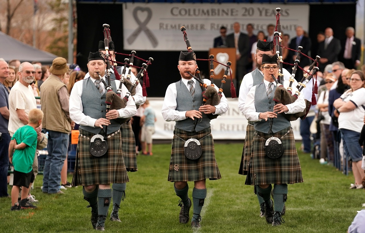 The Queen City Pipe Band closes a ceremony to commemorate the 20th anniversary of the Columbine high school attack in Littleton, Colorado, U.S., April 20, 2019. REUTERS/Rick Wilking