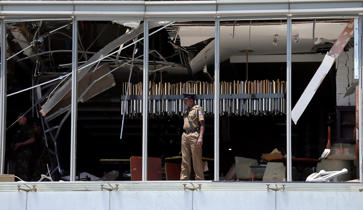 A police officer inspects the explosion area at Shangri-La hotel in Colombo. (REUTERS/Dinuka Liyanawatte)
