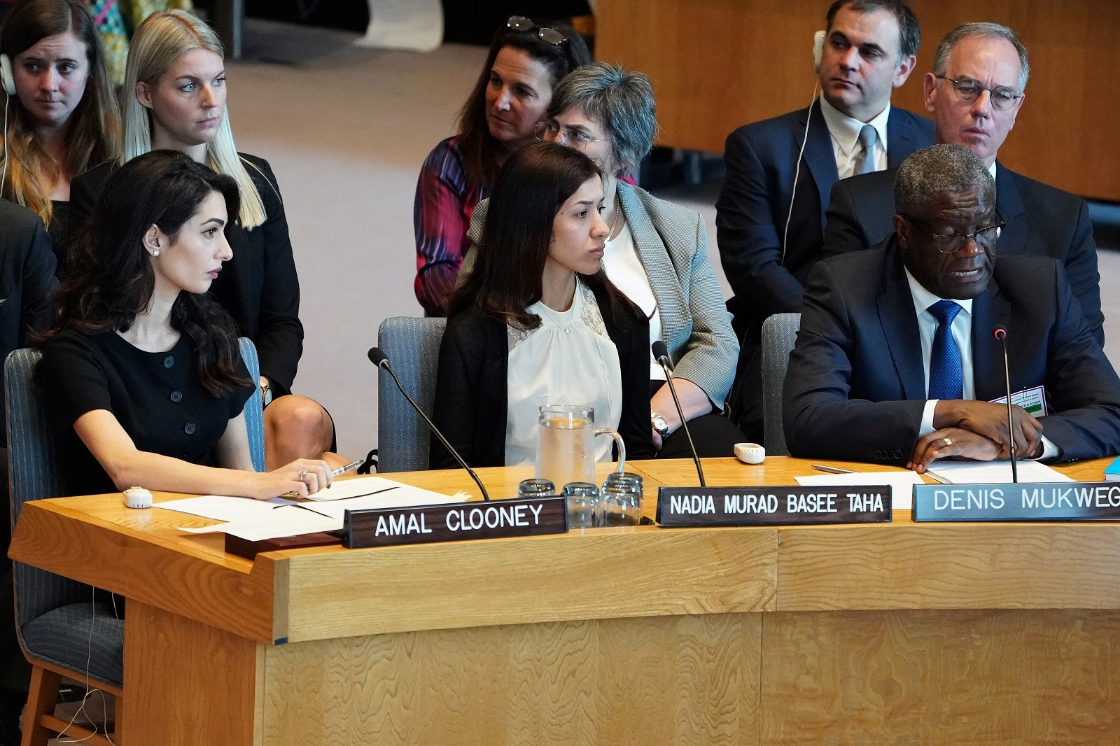 Amal Clooney and Nadia Murad listen to Denis Mukwege speaking at the United Nations Security Council during a meeting about sexual violence in conflict in New York, New York, US, April 23, 2019. REUTERS/Carlo Allegri