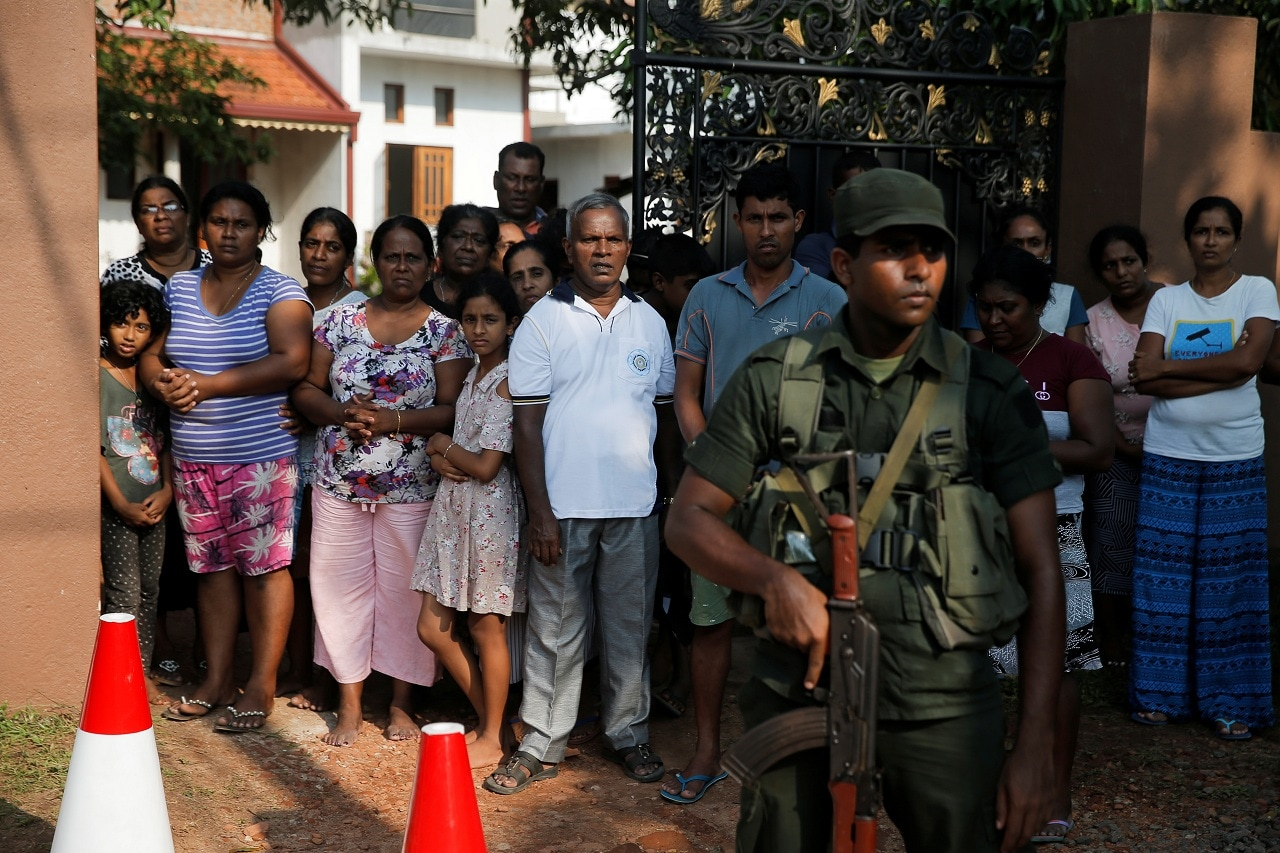 Locals watch a funeral procession, days after a string of suicide bomb attacks on churches and luxury hotels across the island on Easter Sunday, in Negombo, Sri Lanka April 24, 2019. (Reuters)