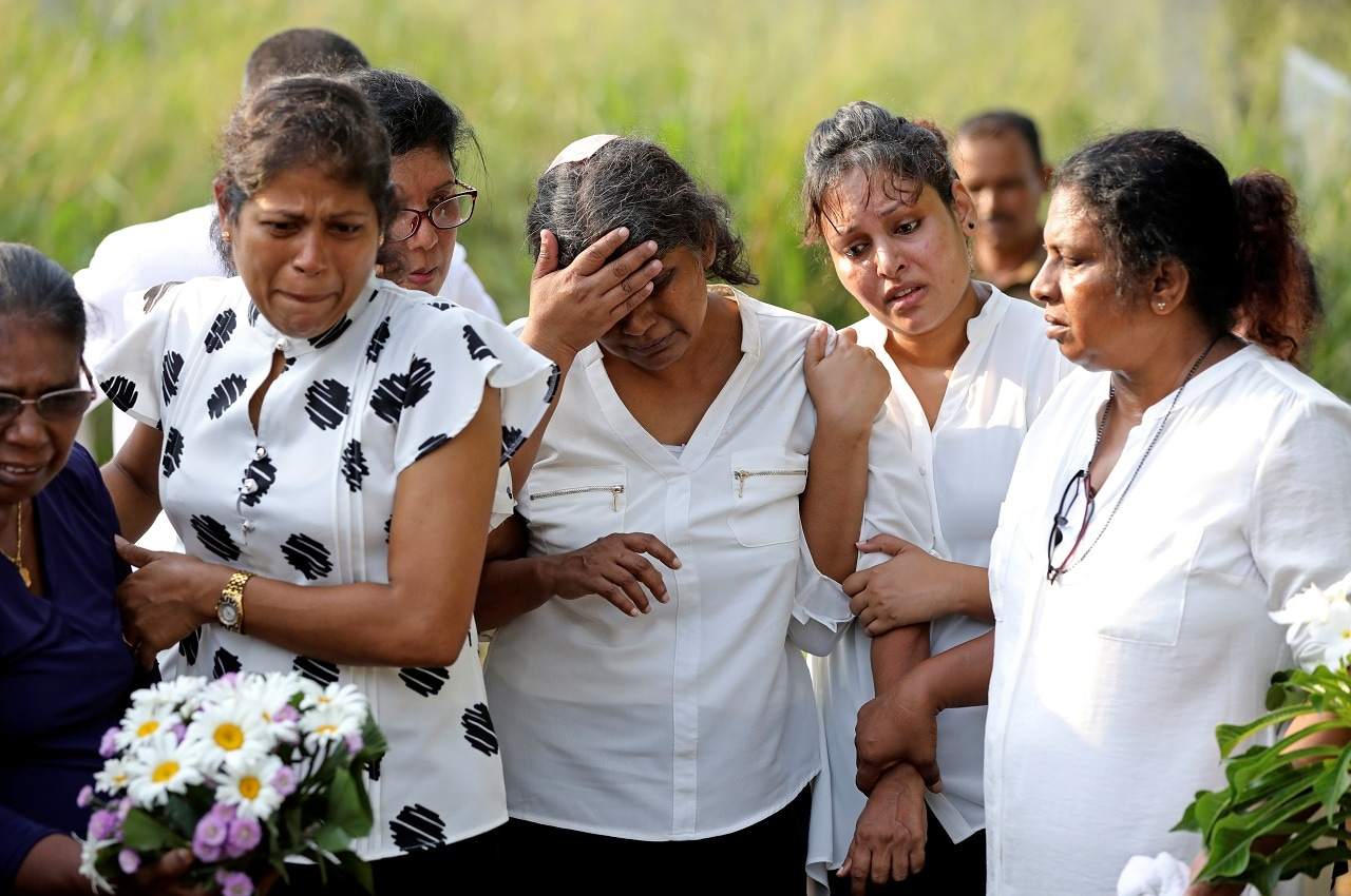 The injured mother of Sajuni, 23, who died during a string of suicide bomb attacks on churches and luxury hotels on Easter Sunday, mourns at her funeral in Negombo, Sri Lanka April 24, 2019. (Reuters)