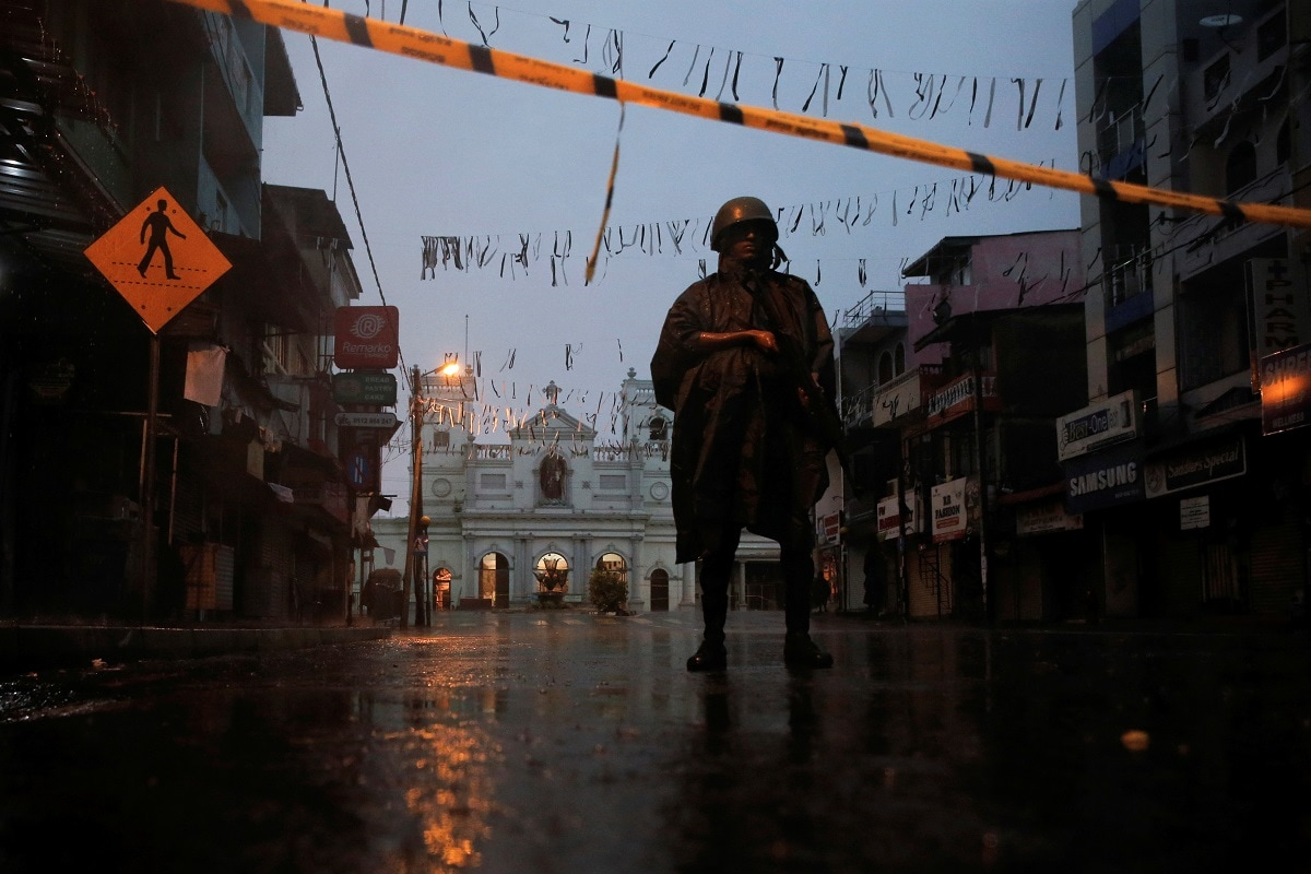 A soldier stands guard at St. Anthony's Shrine during heavy rain, days after a string of suicide bomb attacks on churches and luxury hotels across the island on Easter Sunday, in Colombo. (REUTERS/Thomas Peter)