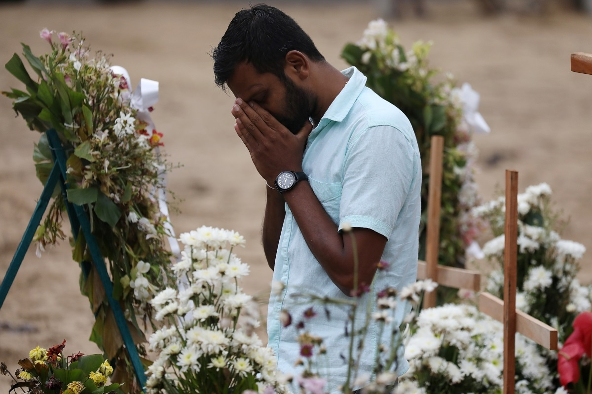 A man reacts during mass burials near St. Sebastian church in Negombo, Sri Lanka. (REUTERS/Athit Perawongmetha)