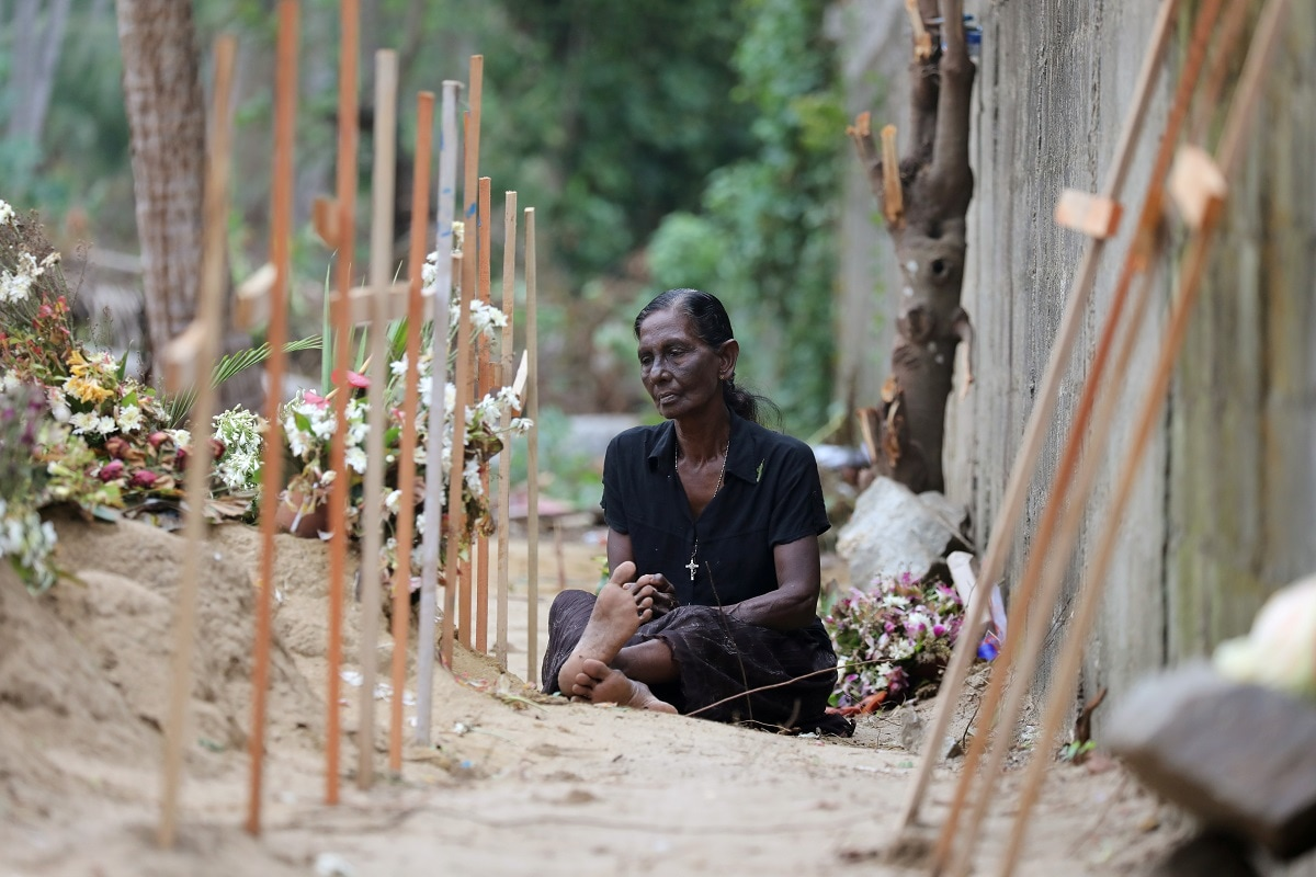 A woman is seen during mass burials near St. Sebastian church in Negombo. (REUTERS/Athit Perawongmetha)