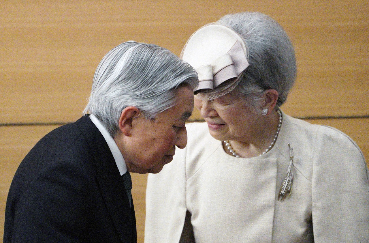 Japan's Emperor Akihito and Empress Michiko greet the guests as they leave from the stage after the awarding ceremony of the Midori Academic Prize Friday, April 26, 2019, in Tokyo. (Reuters)