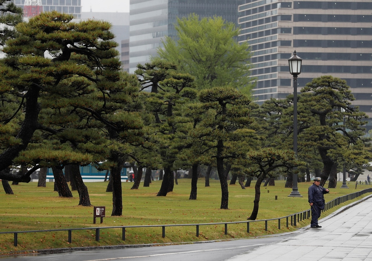 A policeman stands guard near the Imperial Palace in Tokyo, Japan, April 30, 2019. (Reuters)