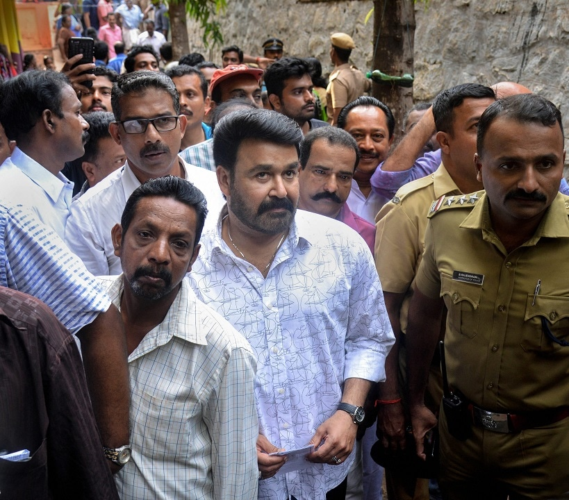 Malayalam films' actor Mohanlal stands in a queue to cast his vote at a polling station, during the third phase of the 2019 Lok Sabha polls, in Thiruvananthapuram, Tuesday, April 23, 2019. (PTI Photo)