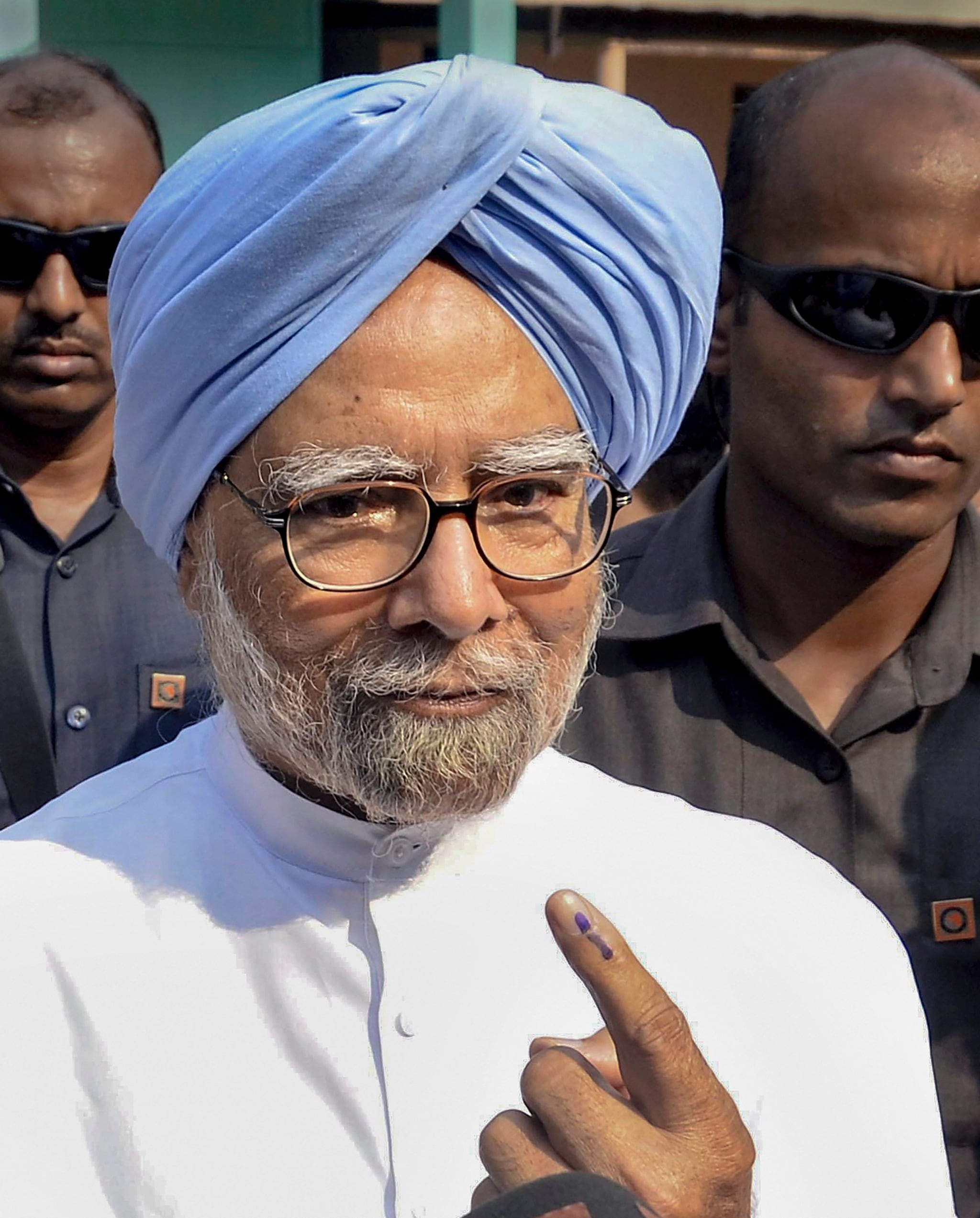 Former prime minister and senior Congress leader Manmohan Singh shows his finger marked with indelible ink at a polling station after casting vote for the third phase of Lok Sabha elections, in Guwahati, Tuesday, April 23, 2019. (PTI Photo)