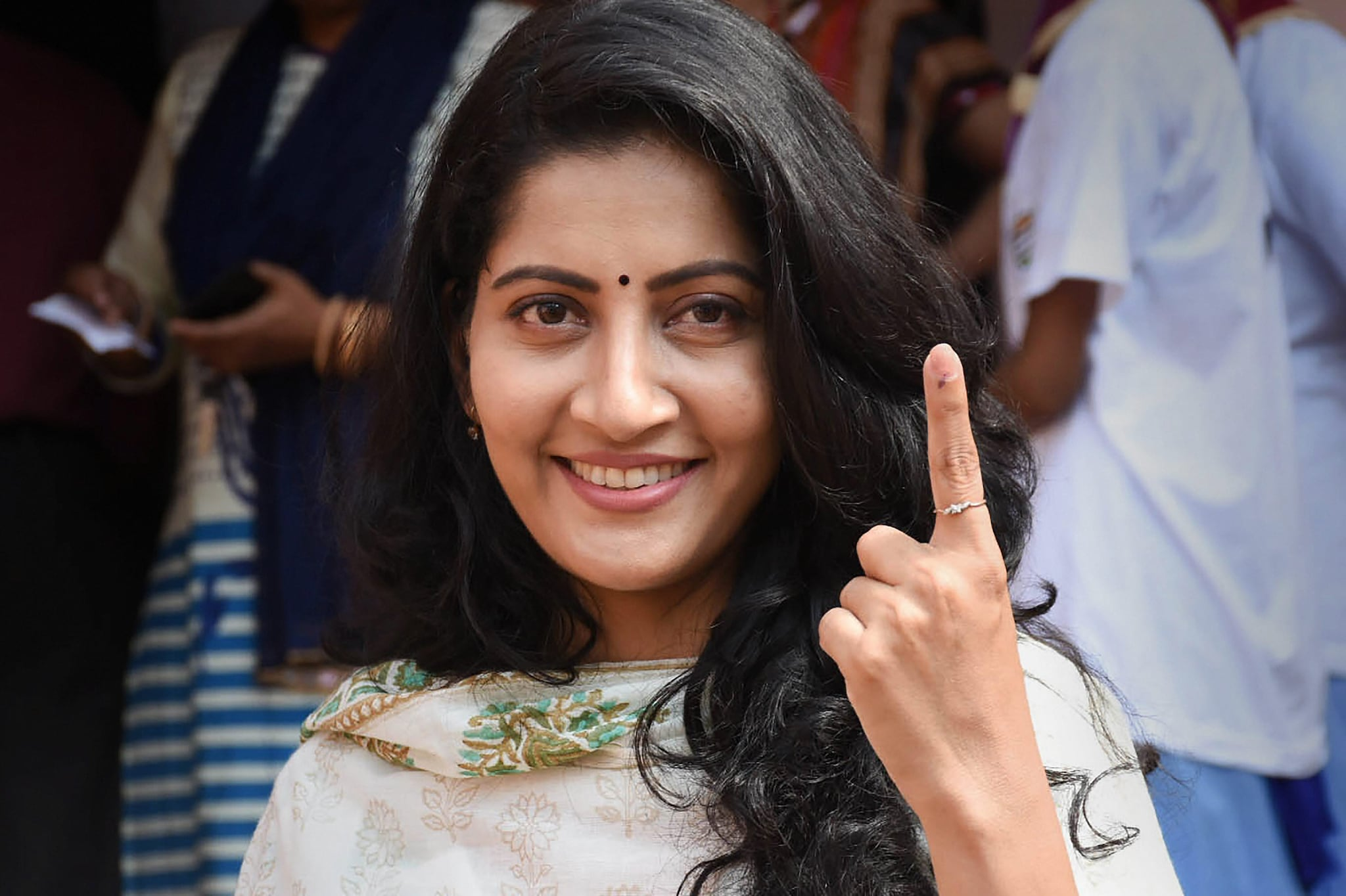 Film actor Anu Choudhury shows her inked finger after casting vote at a polling booth, during the 3rd phase of Lok Sabha elections in Bhubaneswar, Tuesday, April 23, 2019. (PTI Photo)