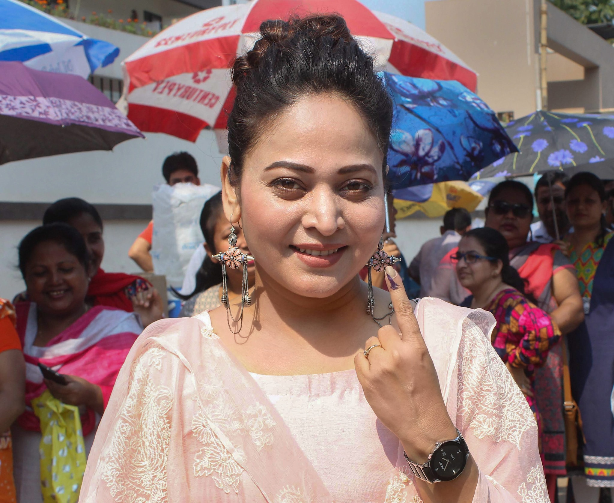 Assamese actress Zerifa Wahid shows her inked finger after casting vote at a polling station, during the 3rd phase of the Lok Sabha polls, in Guwahati, Tuesday, April 23, 2019. (PTI Photo)