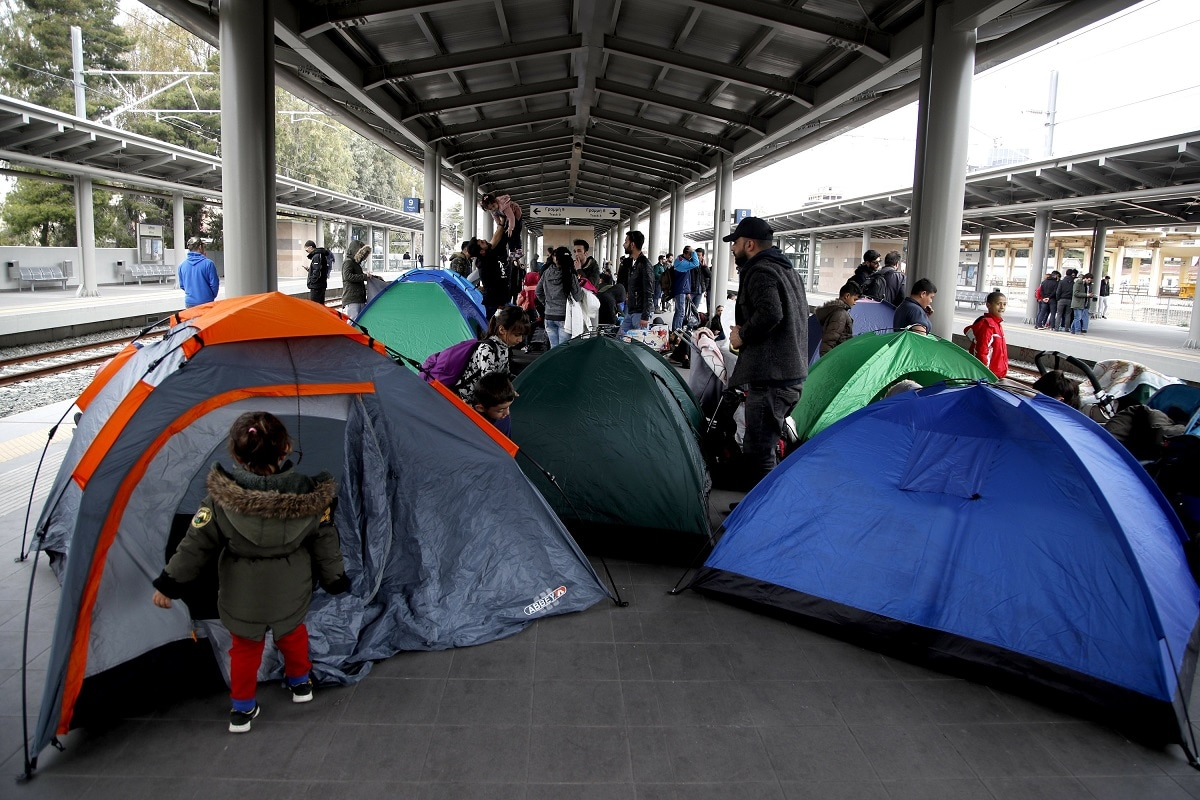 Migrants set up their tents as they blocked the Larissis main rail station in Athens. (AP Photo/Thanassis Stavrakis)