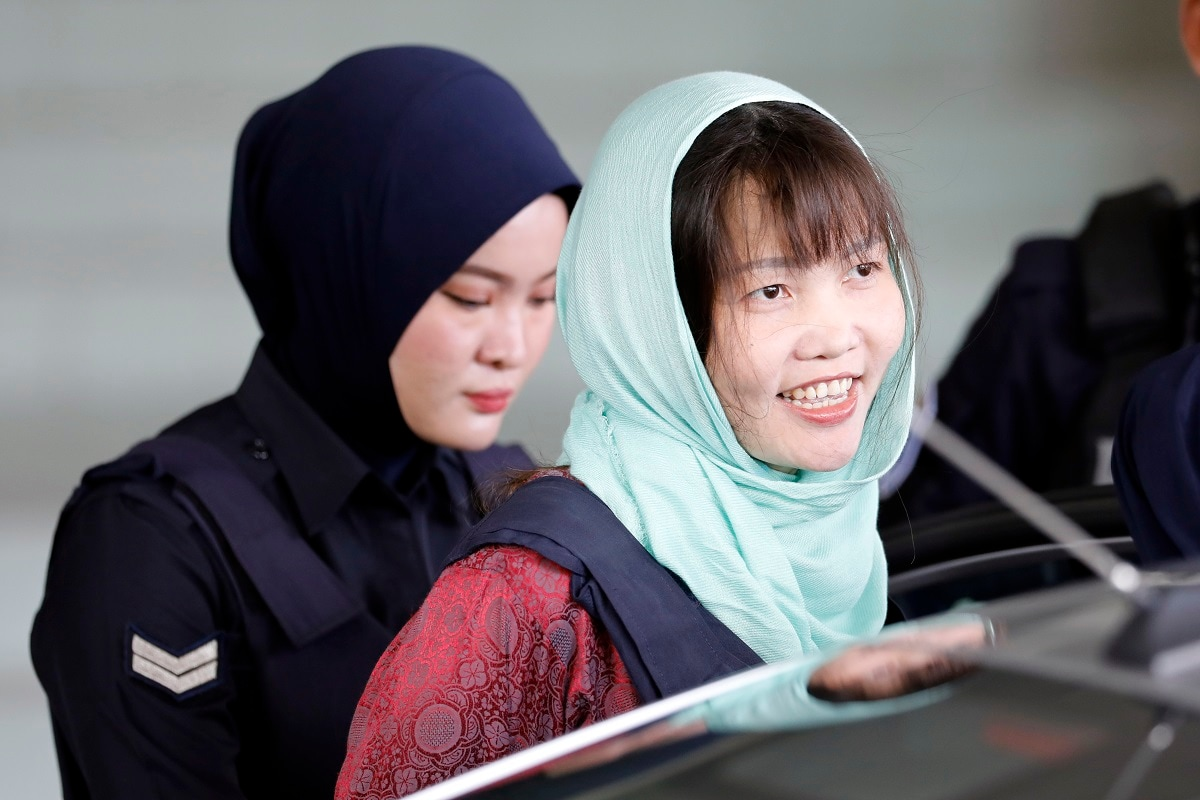 Vietnamese Doan Thi Huong, right, leaves Shah Alam High Court in Shah Alam, Malaysia. The Vietnamese woman who is the only suspect in custody for the killing of the North Korean leader's brother Kim Jong Nam pleaded guilty to a lesser charge in a Malaysian court on Monday and her lawyer said she could be freed as early as next month. (AP Photo/Vincent Thian, File)