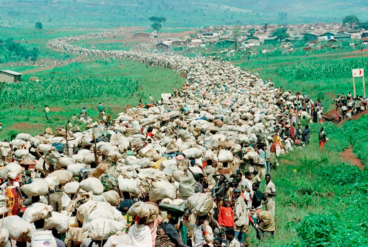 Tens of thousands of Rwandan refugees, who have been forced by the Tanzanian authorities to return to their country despite fears they will be killed upon their return, stream back towards the Rwandan border on a road in Tanzania. (AP Photo/Jean-Marc Bouju, File)