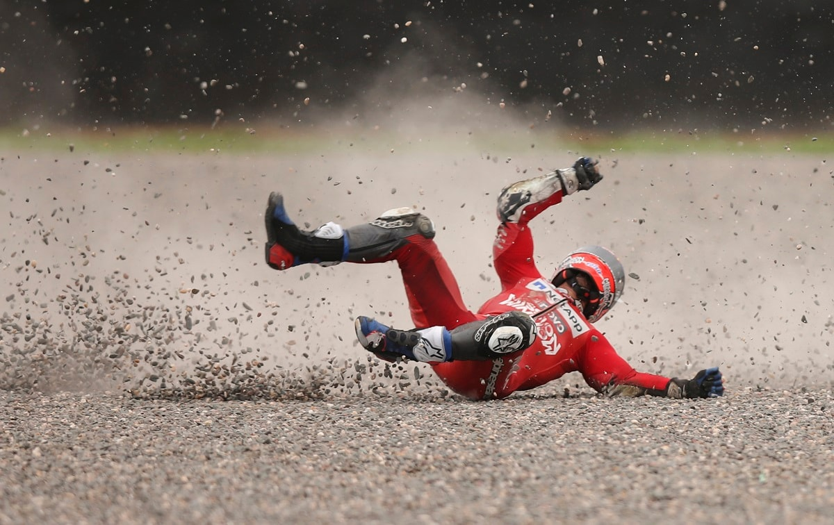 Andrea Dovizioso of Italy falls from his bike during a Moto GP free practice run at the circuit in Termas de Rio Hondo, Argentina. Despite the fall Dovizioso raced in the third pole position on Sunday and finished in third place. (AP Photo/Nicolas Aguilera)