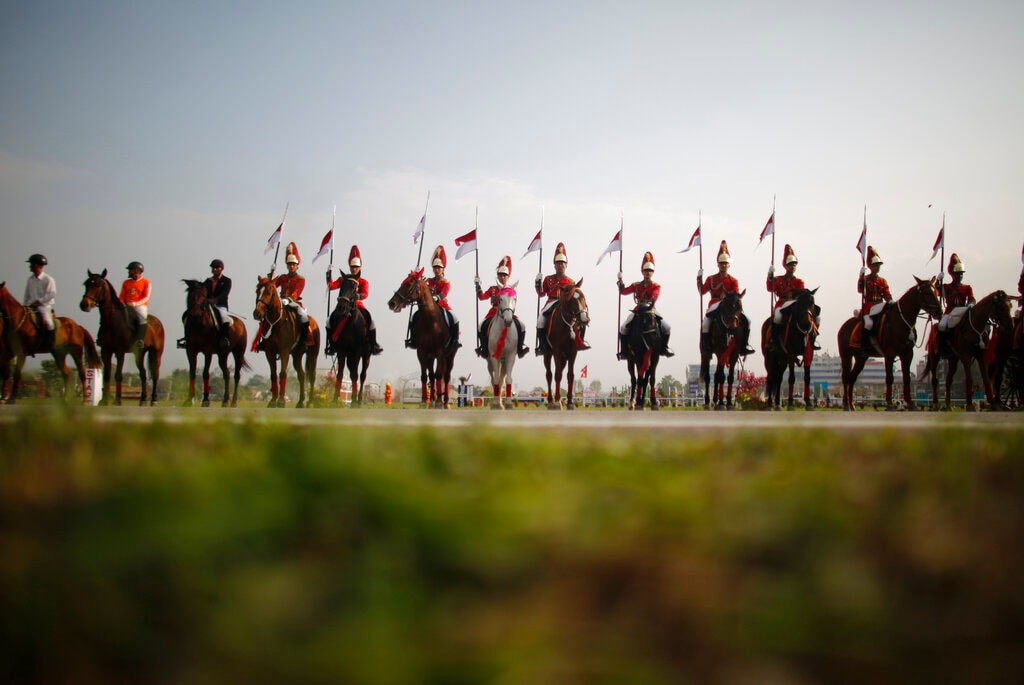 In this April 5, 2019, photo, Nepalese cavalry soldiers rehearse for the Ghode Jatra festival in Kathmandu, Nepal. (AP Photo/Niranjan Shrestha)