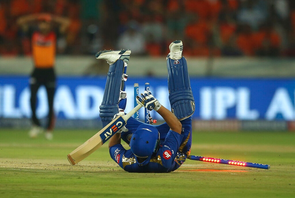Mumbai Indians captain Rohit Sharma falls on the ground in an attempt to make it to the crease during the VIVO IPL T20 cricket match between Sunrisers Hyderabad and Mumbai Indians in Hyderabad, India, Saturday, April 6, 2019. (AP Photo/ Mahesh Kumar A.)