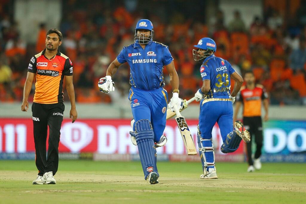 Mumbai Indians' Kieron Pollard, second left, and Hardik Pandya, right, run between the wickets during the VIVO IPL T20 cricket match between Sunrisers Hyderabad and Mumbai Indians in Hyderabad, India, Saturday, April 6, 2019. (AP Photo/ Mahesh Kumar A.)
