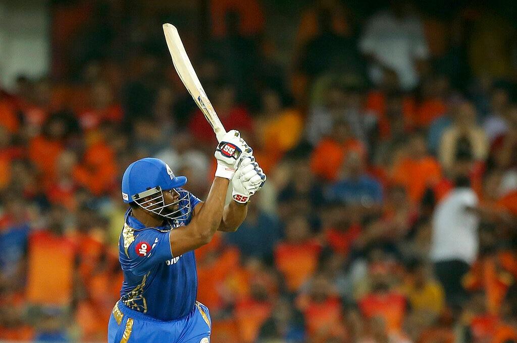 Kieron Pollard plays a shot during the VIVO IPL T20 cricket match between Sunrisers Hyderabad and Mumbai Indians. (AP Photo/ Mahesh Kumar A.)