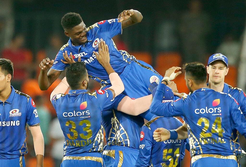 Mumbai Indian team members lift Alzarri Joseph after winning the match against the Sunrisers Hyderabad during the VIVO IPL T20 cricket match between Sunrisers Hyderabad and Mumbai Indians in Hyderabad, India, Saturday, April 6, 2019. (AP Photo/ Mahesh Kumar A.)