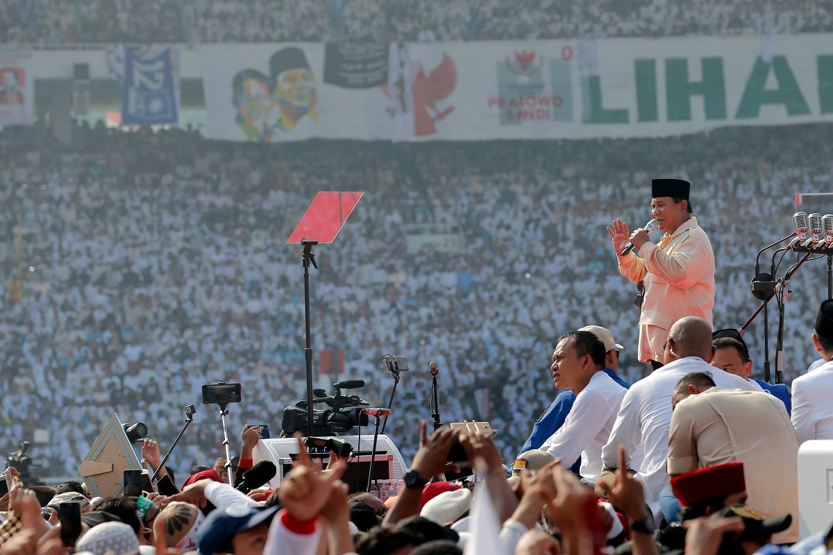 Indonesian presidential candidate Prabowo Subianto, right, speaks to supporters during a campaign rally of his Great Indonesia Movement Party at Gelora Bung Karno Stadium in Jakarta. The world's third-largest democracy is gearing up to hold its legislative and presidential elections on April 17. (AP Photo/Tatan Syuflana)