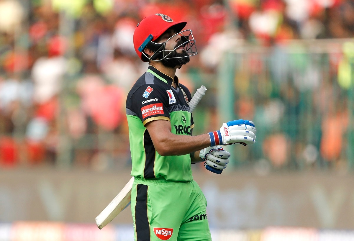 Royal Challengers Bangalore captain Virat Kohli reacts as he leaves the field after being dismissed. (AP Photo/Aijaz Rahi)