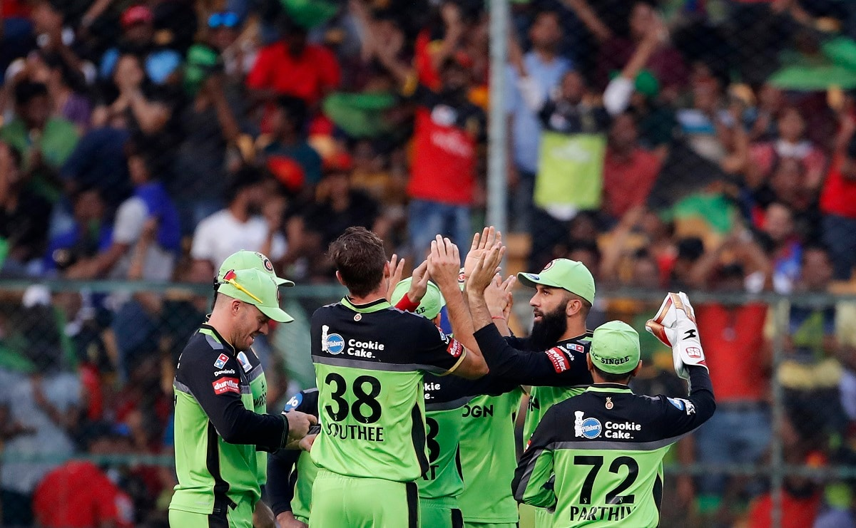 Royal Challengers Bangalore players celebrate the dismissal of Delhi Capitals' Shikhar Dhawan. (AP Photo/Aijaz Rahi)