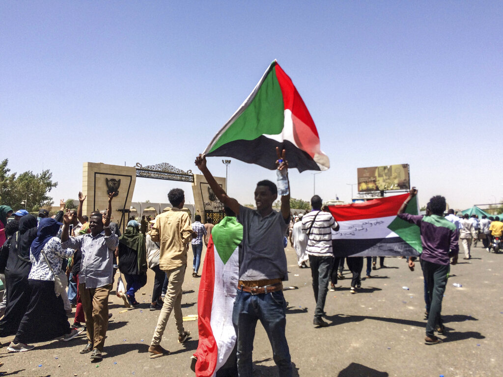 Protesters display Sudanese flags at a rally in front of the military headquarters in the capital Khartoum, Sudan, Monday, April 8, 2019. (AP Photo)