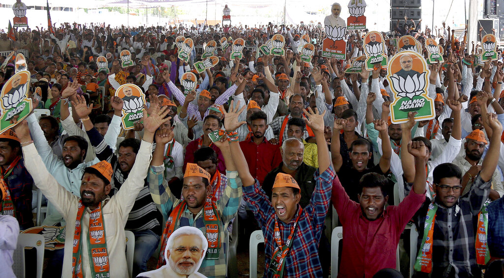 Bharatiya Janata Party (BJP) supporters cheer at an election campaign rally in Hyderabad, India. (AP Photo/ Mahesh Kumar A)