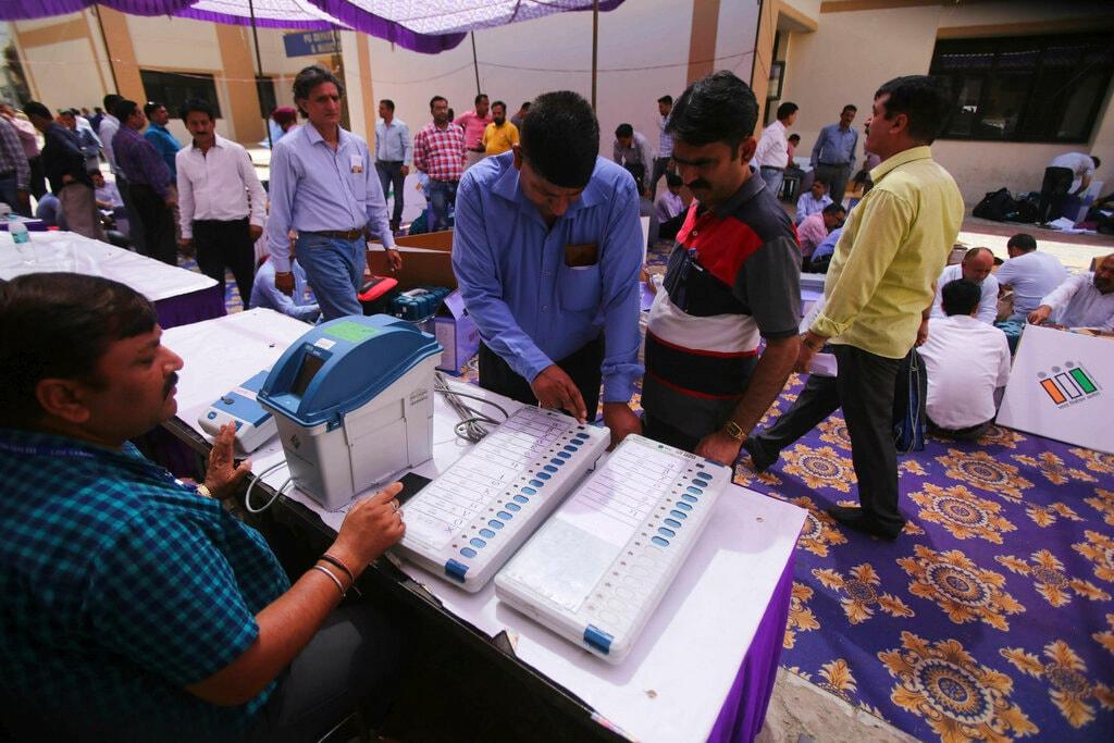 Election Commission officials check electronic voting machines before leaving for their polling booths in Jammu, India, Wednesday, April 10, 2019. (AP Photo/Channi Anand)