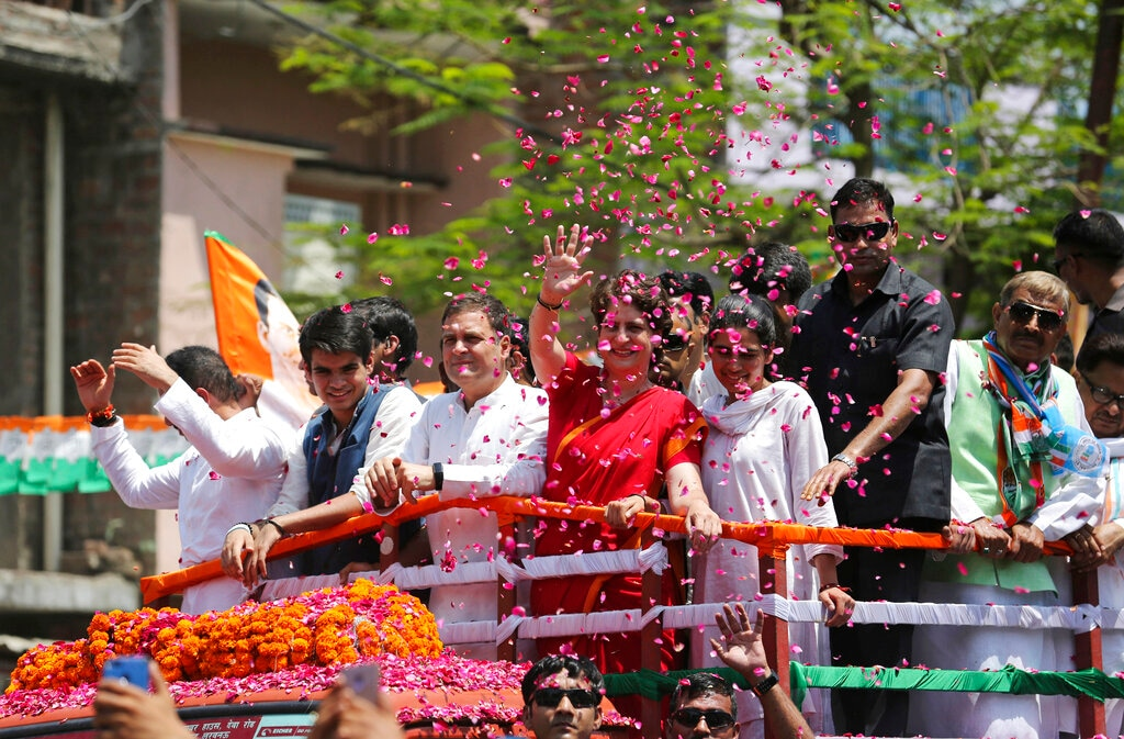 Congress party chief Rahul Gandhi, center in white, accompanied by his sister Priyanka Vadra in red arrives to file his nomination papers for the upcoming general elections in Amethi, Uttar Pradesh state, India. (AP Photo/Rajesh Kumar Singh)