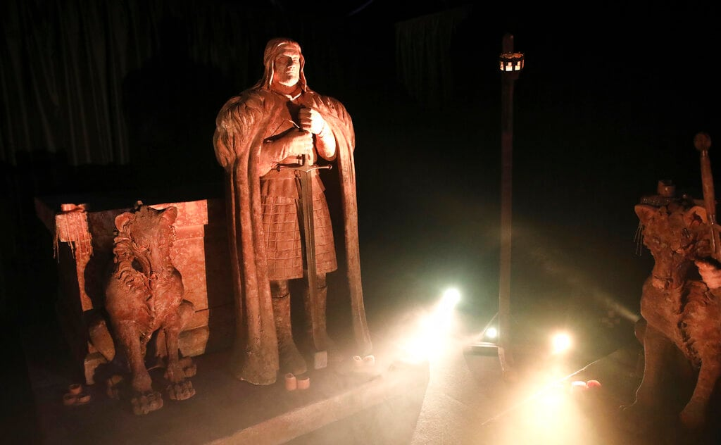 The statue of Ned Stark from the crypts of Winterfell are on display during the launch of The Game of Thrones Touring Exhibition at the Titanic Exhibition centre in Belfast, Northern Ireland, Wednesday, April 10, 2019. (AP Photo)