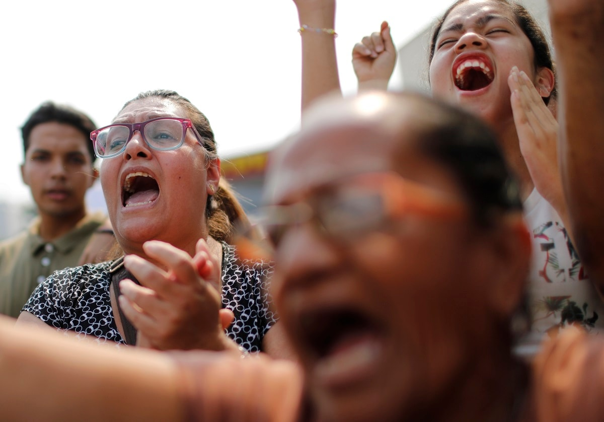 Supporters of opposition leader Juan Guaidó, who has declared himself Venezuela's interim president, screams slogans against President Nicolas Maduro during a rally with Guaidó in the San Martin area of Caracas, Venezuela. Vice President Mike Pence addressed the UN Security Council on Wednesday and urged the UN to recognize Guaidó as Venezuela's president in place of Nicolás Maduro. (AP Photo/Ariana Cubillos)